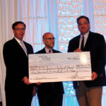 John Taylor, Jr., Chairman, Twin River Worldwide Holdings, Inc.; Andrew Schiff, CEO, RI Community Food Bank; Craig Sculos, Vice President and General Manager, Twin River Casino.