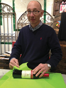 Fred Argilagos individually wrapping each bottle sold.