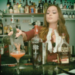 Stephanie Merola of The Dorrance pouring her cocktail.