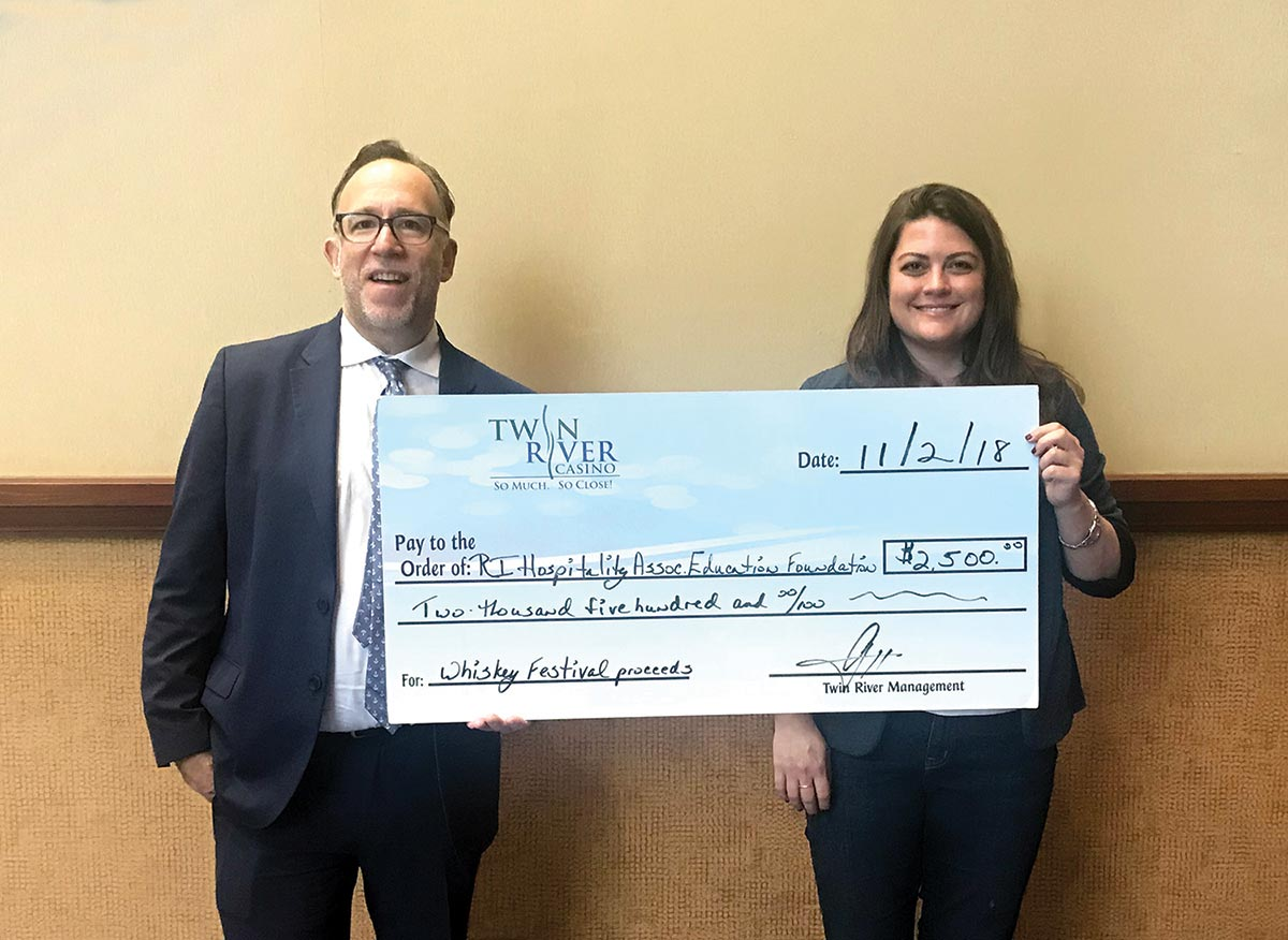 Annual Whiskey Festival Representative Presents Check to Event Beneficiary