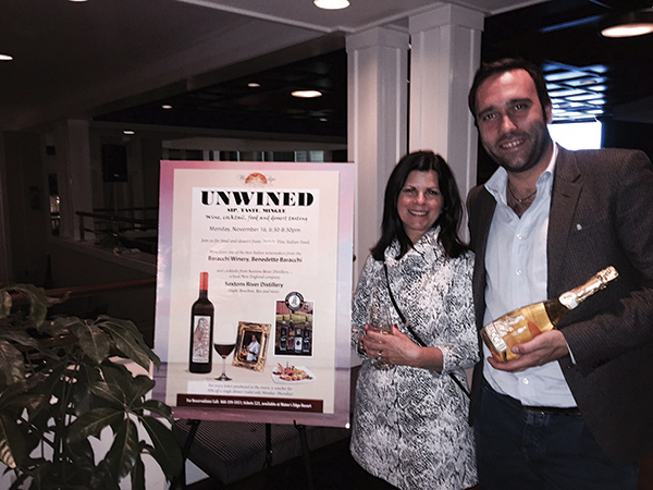 Baracchi holds a bottle of his Brut Trebbiano with guest Elaine Beame at the Water's Edge event.