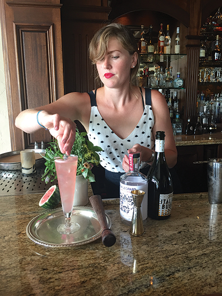 "Bartender Willa Van Nostrand mixes up a ""Dandy Lion"" cocktail at The Chanler, Newport."