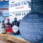 A Yacht Hop cocktail menu with selection showcasing Hendricks Gin, Solerno Liqueur, Glenfiddich and Sailor Jerry Rum.