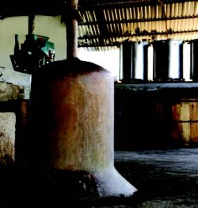 Like tequila, mezcal production—seen here at Mezcales de Leyenda—involves cooking agave piñas before fermenting and distilling. Critical differences: for mezcal, agave is sourced from anywhere, not just Jalisco; and many types of agave are permitted.