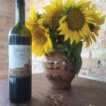 A display of sunflowers, which are grown on the Angelini property, with Angelini Estate Sangiovese DOC Riserva.