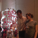 Abbie Kundishora, Sales and Promotions Manager, Bom Bom Brands, with a guest using the Bom Bom Brands ice luge.
