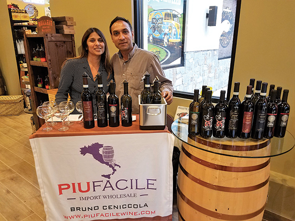 Owners Varsha and Prashant Mehta of Cork & Barrel in Hamden providing tastes of Piu Facile wines.