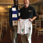 Omar Tall, University of Hartford soccer player and current CT United FC player with Richard Visco, CEO, Shebeen Brewing Company, showing off the Shebeen Brewing logo on the CT United uniform.