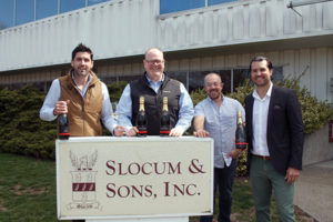 Noah King-Smith, Key Account Manager Hartford/New Haven, Slocum & Sons; Paul Burne, Key Account Manager Fairfield/Litchfield, Slocum & Sons; Alex Meier-Tomkins, Boutique & Craft Brands Director, Slocum & Sons; Brenton Blanchard, ABCK Corp., outside of Slocum & Sons with Chapel Down wines.