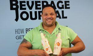 Darchell Wilson, Sales Representative, Latitude Beverage, with Mija White Sangria.
