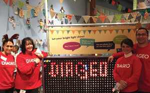 Diageo employees pose with the giant Lite-Brite™ exhibit at the Stepping Stones Museum for Children in Norwalk. Over 100 Diageo volunteers worked directly with groups of underprivileged children during the holiday party.