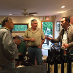 Baracchi speaks with guests at a wine class at Divine Wine Emporium in Niantic.