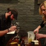 Conrad Meurice and Emily Blewett of Elm City Social preparing their cocktail.