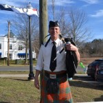The bagpipe player in front of Empire Wine and Liquor played traditional Irish hymns for customers.