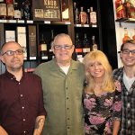 Store Owners Keith, Kevin and Donna Ploski and employee Timmy Chapman.