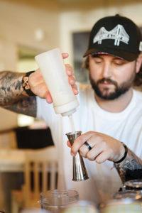 Tyler Bernadya creating the winning cocktail, Castaway Coolada.