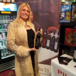 A Gabel's customer and wine enthusiast visiting the Piu Facile wines display.