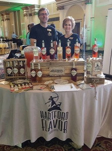 """Tom and Lelaneia Dubay, Founders of Hartford Flavor Company. Hartford Flavor Company featured a signature cocktail """"Jessica Rose,"""" that showcased its Wild Moon Rose Liqueur, vodka and lemonade. The Wild Moon line includes botanically-infused Cucumber, Cranberry, Rose, Lavender, Birch and Chai Spice flavors."""