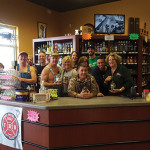 Tim Smith, center, visits with the staff of Big Gary's Montville Wine and Spirits in Montville.