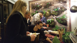 Guests sampling hors d'oeuvres.