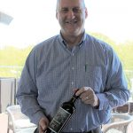 Brett Powell, Constellation Brands, holding Ravage Cabernet Sauvignon 2015 of California.