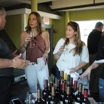 Sal Spenn, Shannon Ridge Vineyards speaking with Kaila Maurer, Sarah Smith and Courtney Eslin, all from Court House Bar and Grill in Putnam.