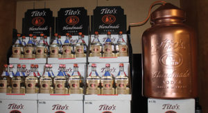 """Tito's Handmade Vodka of Austin, Texas, displayed during the celebratory sales meeting on April 7. The vodka brand, produced in the first legal distillery in Texas, was founded by Bert Butler """"Tito"""" Beveridge II."""