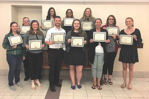 Mia Ginter (second in back from left) and Danielle Mason (back row, first on left) both of Brescome Barton, surrounded by fellow graduates in the Human Resource Certification program at CCSU.
