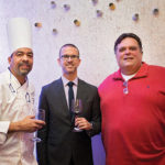 Hotel Viking Executive Chef Barry Correia; Matt Hobbs, Winemaker, Paul Hobbs Winery, next to a consumer and guest during the Hotel Viking wine dinner. Photo by Meagan Emilia Photography.
