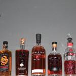 Portfolio of Hood River Distillers on the shelf at Camp's Restaurant. Sinfire Cinnamon Whisky, Trail's End Bourbon, Pendleton Whisky, Pendleton Midnight, Pendleton 1910 Rye Whisky.