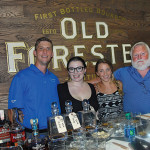 All from J. Timothy's Taverne: Sean Murphy, Manager; Lauren Hansen, Bartender and Supervisor; Marrit Budny, Bartender and Supervisor; Tim Adams Co-owner, beside the Old Forester sign and tasting table.