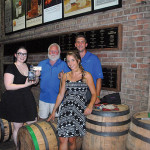 All from J. Timothy's Taverne: Lauren Hansen, Bartender and Supervisor; Tim Adams Co-owner; Marrit Budny, Bartender and Supervisor; Sean Murphy, Manager with a bottle of Old Forester.