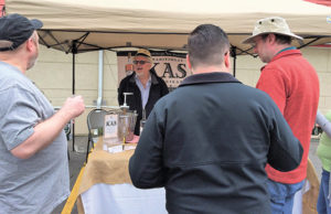 Kas Katinas, Co-founder, Kas Spirits speaking with guests at the Little Poland Festival in New Britain on April 30.