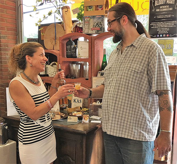 Cordelli talks with a guest at Val's Putnam Wine in Greenwich.