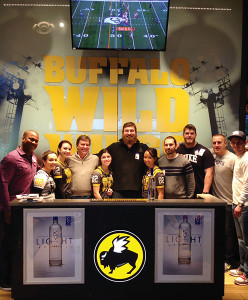 Jon Mason, Sales Representative, M.S. Walker (far left); Bill Dessel, Co-Owner, Keel Vodka (fourth from left); Matt Light, Co-Owner, Keel (center); with the team at Buffalo Wild Wings in Warwick along with Keel contest winners.