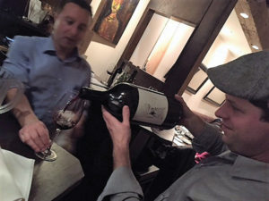 Michael Munk, Regional Sales and Portfolio Manager CT/NY/NJ, Latitude Beverage, pouring from a 3-liter limited edition bottle of Magic Door Rosso, a super Tuscan blend.