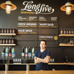 Armando DeDona, owner and brewer of Long Live Beer, inside the tasting room.