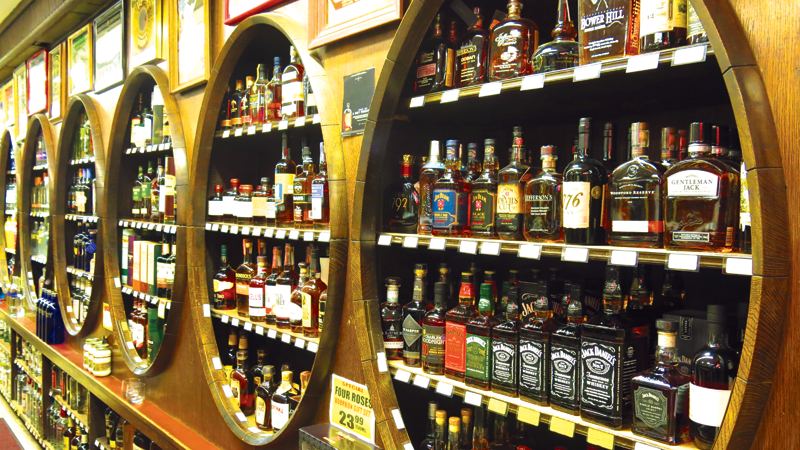 Whiskey fills three barrel-shaped shelf areas at Lowery's in Sunnyside, Queens.
