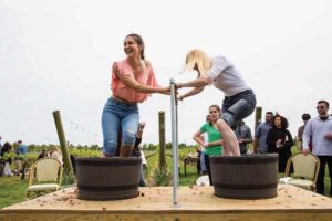 Guests at the Newport Vineyards Spring Celebration enjoy a grape stomping contest.