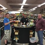 Jeff Gaurdreau, Sales, Liquid Assets Fine Wine & Spirits (center) surrounded by fans of Newport Storm while promoting the latest release Rhode Trip on June 23.