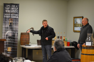 Adam von Gootkin demonstrated how moonshine is made. Jeff Cornelius, Off-Premise Brand Manager for CT and RI looks on