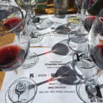 The wine tasting mat during the educational luncheon led by Charles Smith, Owner and Winemaker of Charles Smith Wines and K Vintners.