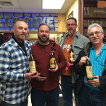 Four out of the six happy customers who won the raffle for a chance to purchase the elusive whiskies.