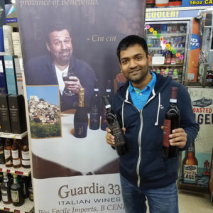 Neil Patel, Owner, Thompson Liquors, showcasing Guardia 33 wines.