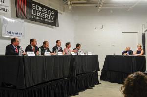 Gubernatorial candidates Ken Block, Allan Fung, Todd Giroux, Clay Pell, Gina Raimondo, Angel Taveras with moderators David Dadekian and Jessica Wood.