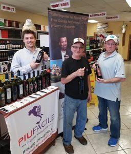 Village Wine & Liquors Employee Lou Tarantino with Ed Della Vecchio, Sr. and Ed Della Vecchio, Jr., Owners, Village Wine & Liquors in Monroe