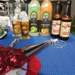 "Table display during Pogash's guest appearance on ""The Rhode Show,"" celebrating the Fourth of July with cocktails featuring Newport Storm Beer and Solerno Liqueur among ideas."