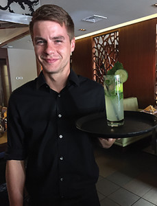 Server Randall Pietsch and Nami's Cucumber Sake Mojito.