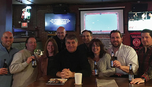 All Horizon Beverage employees except when noted. Front row: Steve Morelli; Tom Ratier; Colleen O'Brien; Ray Bourque, Boston Bruins Alum and National Hockey League Hall of Famer; Ann Buonaccorsi; Ryan Broz; Tim Sheehan; Back row: Jim Hulslander, District Manager CT/RI, North American Breweries; Bob Buonaccorsi, Horizon Beverage, Copley Division.
