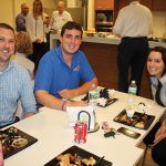 Rhode Island Distributing Company's Kyle Grudzien, Michael Pauchspies and Brittany Amaral.
